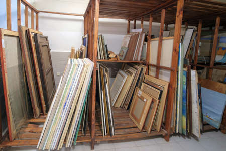 Batumi, Georgia, December, 17, 2020: Batumi Art Museum, Wooden shelves at art gallery storage full of pictures and art equipment