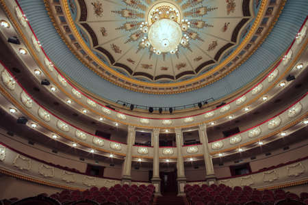 Batumi, Georgia, December, 22, 2020: Batumi Drama Theater. The interior of the hall in the theater with large chandelier hangs on the decorated ceiling
