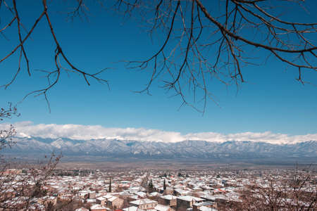 Beautiful view of Caucasus mountains from the town covered with snow