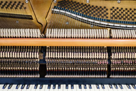 View inside of an old piano, repair and tuning of musical instruments