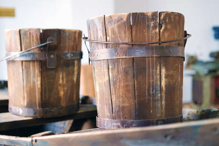 Old wooden buckets on wooden surface, selective focus 版權商用圖片