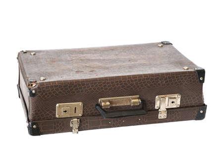 Old vintage leather suitcase made of fake crocodile skin isolated on white background