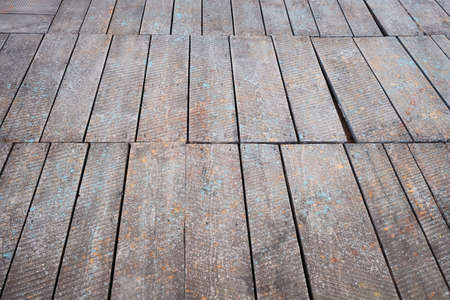 Surface of a grunge wooden floor detail in perspective
