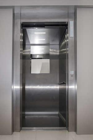 Open metallic dirty passenger lift door