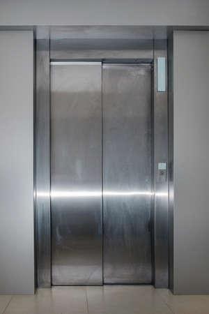 closed metallic dirty passenger lift door 版權商用圖片