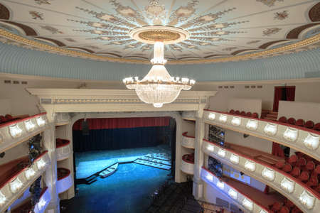 Batumi, Georgia, April, 5, 2021: Batumi Drama Theater.  Large chandelier hangs on the theater hall decorated ceiling 新聞圖片