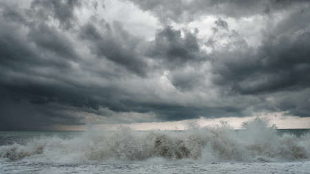 View of a stormy sea and dramatic cloudy sky, big waves are crashing on the shore 版權商用圖片