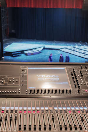 Professional stage lighting control console with blurred background of a theater stage Standard-Bild