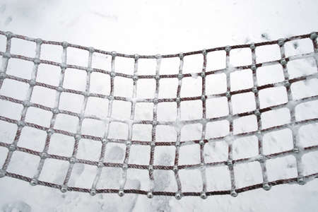 A hammock covered with snow. Winter concept