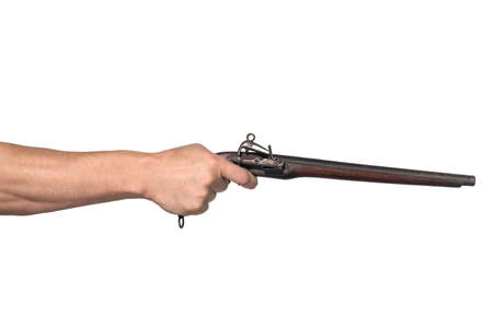 Man's hand holds a old style brown pistol, isolated on a white background