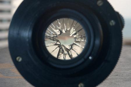 Closeup view of a broken camera lens on blurred background, selective focus Standard-Bild