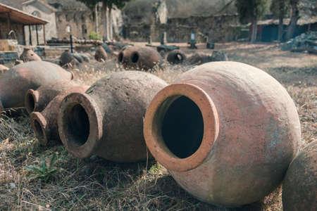 Georgian traditional ancient jug for wine qvevri on the field, selective focus Standard-Bild