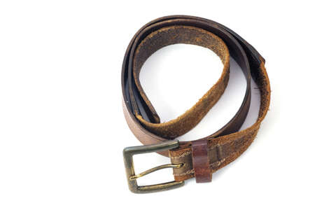 Used brown leather belt isolated on white background Standard-Bild