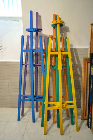 Stack of the different wooden color easels