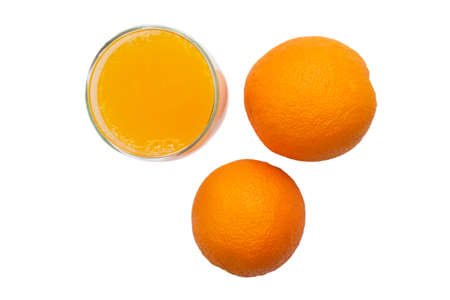 Top view of a ripe oranges and a glass of fresh squeezed orange juice on white background.