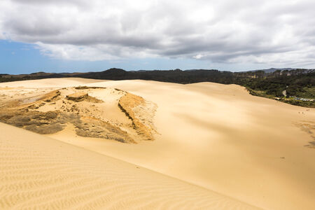Sandy dunes and a single rock 版權商用圖片