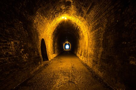 Abandoned rail tunnel in an old gold mine
