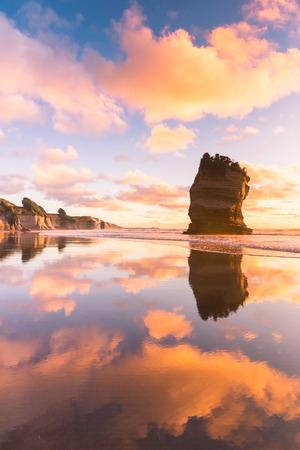 Lone rock at the sunset beach 版權商用圖片