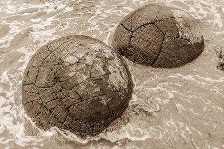 Sepia toned Moeraki boulders in a high tide. Otago, New Zealand 版權商用圖片