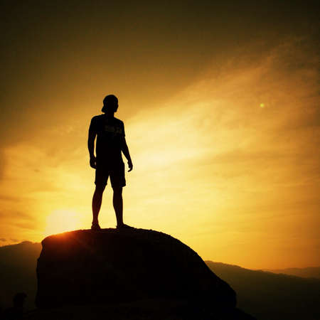Silhouette man standing in sunset