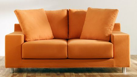 isolated modern orange couch Archivio Fotografico