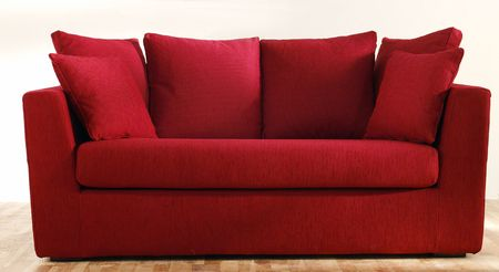 red couch: isolated modern red couch Stock Photo