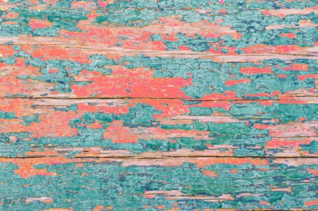 The rough wooden surface in the coral color