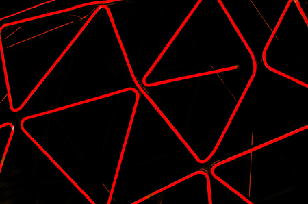 Rhythmic neon lines on a black background. Abstract picture. disco style