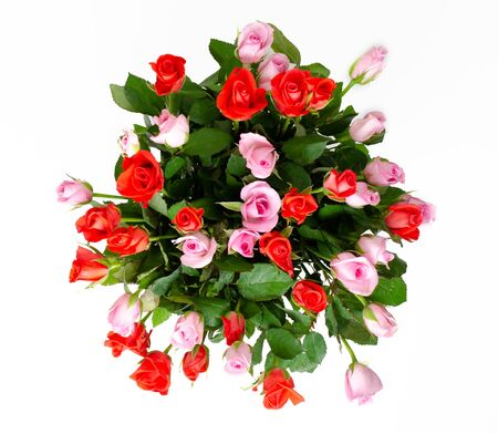 Bouquet of cute red and pink roses. Delicate bouquet for a woman.