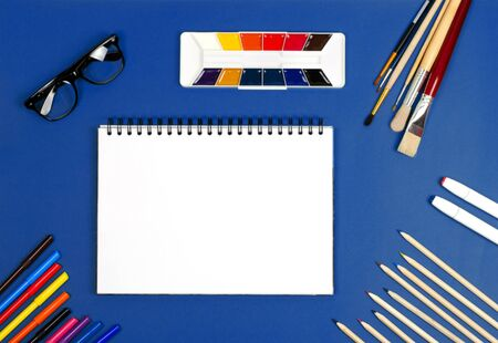White Notepad for writing or drawing. Back to school. Drawing with pencils and paints.