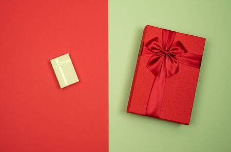 Big and small gift. Red and green background.