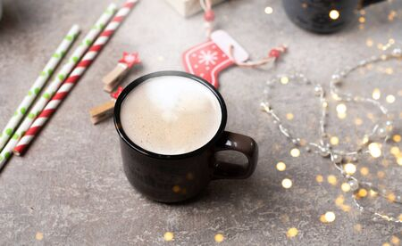 Cozy Christmas photo. Cup of cocoa, Christmas decor, glitter. Magical atmosphere. Stock Photo