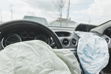 the airbag is fired during the accident. Blue. The inscription airbag and the sticker on the panel.