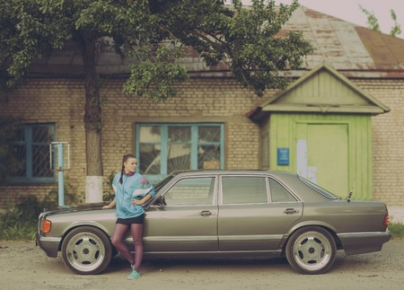 nineties: The girl in the nineties is about cars and looking in the direction