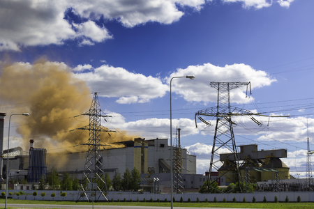 steel plant pollutes the environment with clouds of red smoke. The environmental problem. Stock Photo