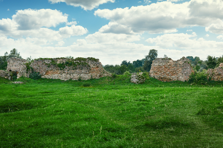 Ruins of an ancient castle in Belarus. The remains of stone walls. Historical and cultural center