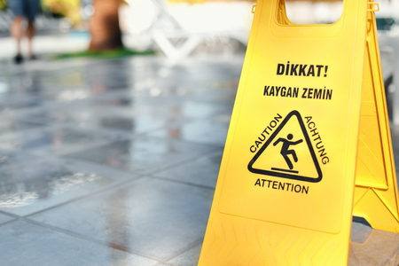 mopped: Yellow warning caution sign slippery floor is tile