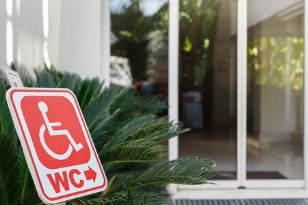 wheelchair users: red sign of toilet for wheelchair users. all inclusive hotel with attention to persons with disabilities.