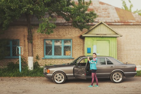 The girl in the nineties is about cars and looking in the direction