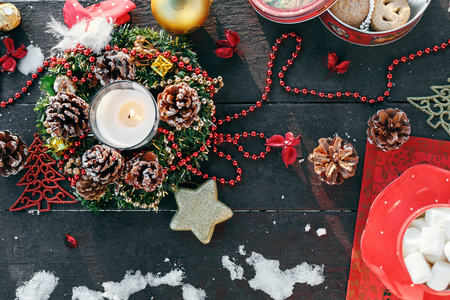 The new years table decoration candle wreath, fir, Christmas toys, pine cones and other things
