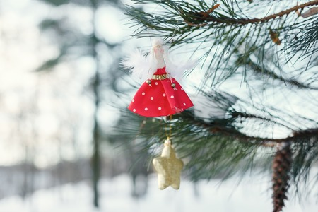 Christmas toys on a Christmas tree. ballerina doll and the star on the tree Stock Photo