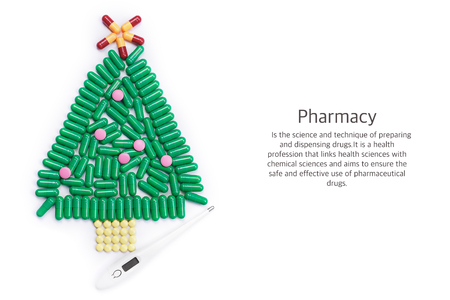 Tablets in form of Christmas tree and thermometer under it