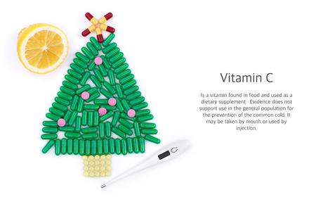 pilule: Tablets in form of Christmas tree thermometer and lemon underneath