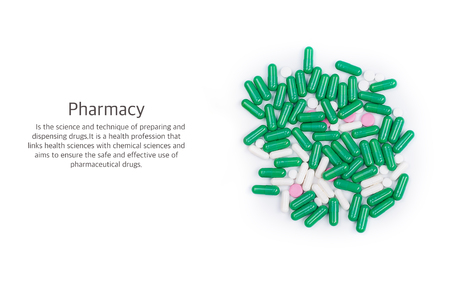 pilule: bunch of tablets piled on white background