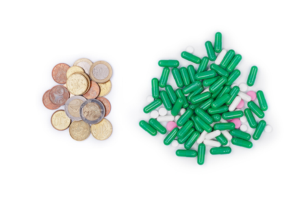 Money next with pills on white background
