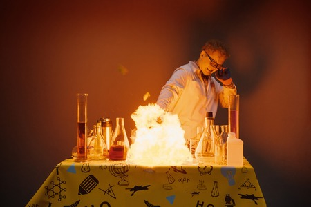 Professor in the laboratory, conducting chemical experiments with explosions Stock Photo