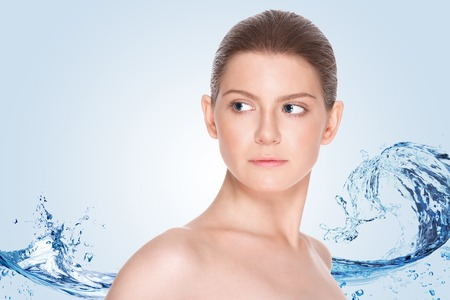 Beautiful girl with clean skin on a background of splashing water Stock Photo