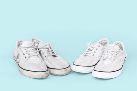 Pair of clean and dirty sneakers on turquoise background