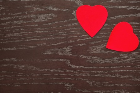 two red velvet hearts on a wooden Board on Valentines day Stock Photo
