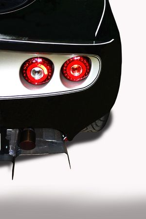Back of sport car with red backlights on white background